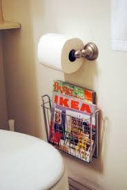 magazine rack wall mount: wall mounted magazine holder under toilet paper holder to maximize