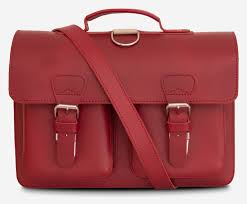 front view of red leather satchel backpack with 2 gussets and symmetric front pockets for women
