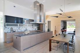 modern kitchen with gray quartz countertops marble backsplash
