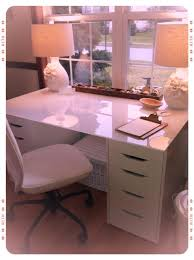 home office ikea alex drawer units paired with an ikea glass kitchen table top to create a desk