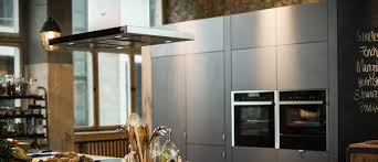 ceiling installation cooker hoods man enjoys cooking in a kitchen containing neff appliances