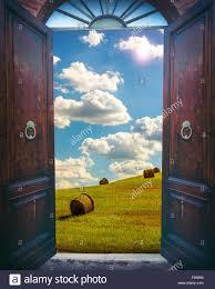 old open door and rural landscape with haystacks