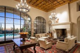 beautiful living room with box ceiling large stone fireplace and rustic chandeliers