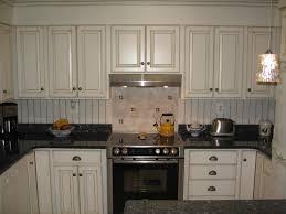attractive kitchen design with cabinet door replacement and beadboard backsplash