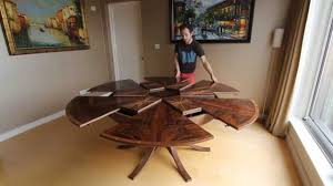 contemporary round dining table with leaf extension