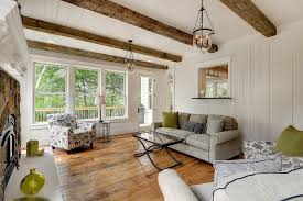 wood beams on ceiling porch transitional with four season