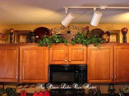 decorating above kitchen cabinets with greenery greenery above kitchen cabinets best top of kitchen cabinets images
