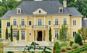 the 14 000 sq foot french style estate sits on 2 beautifully landscaped acres named for its sunny golden façade château soleil is