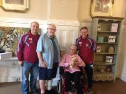 Woodbury House Care Home is presented with Youth Football League Trophy    brighterkind