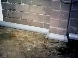 baseboard basement drain pipe system in