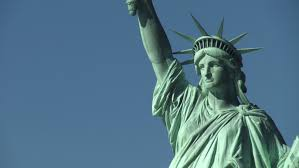 statue of liberty seen from the hudson river new york city usa zoom out to reveal statue and island