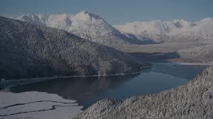 Video By The Lake 4k Stock Footage Aerial Video Descend Toward Carmen Lake Snowy Chugach Mountains Alaska