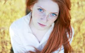 Blonde blue brunette eyed redhead