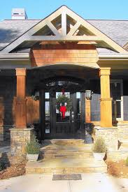exterior columns on homes. entry portico with cedar #columns on stacked stone pedestal. we love a #rustic. rustic houseswooden houseshouse exterior columns homes -
