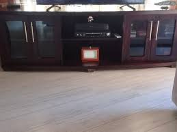 dark brown tv cabinet with glass doors