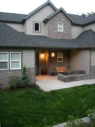 Exterior with custom stone water feature and dry stack stone contemporary- exterior