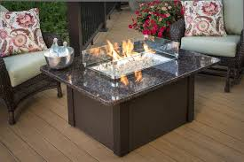 granite top costco fire pit on wooden floor