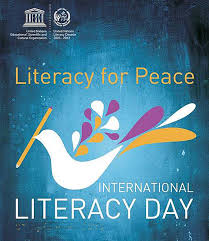 towards an enlightened dawn a file picture of unesco international literacy day 2011 poster
