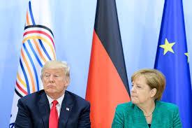 Donald Trump attacks Angela Merkel over open-door immigration policy