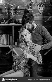 couple in love reading poetry in warm atmosphere couple in wooden vine interior enjoy poetry romantic evening concept