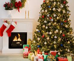 Christmas tree with presents and fireplace with stockings | The ...