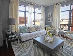 animal print rugs living room transitional with white curtains nesting tables ottoman coffee table