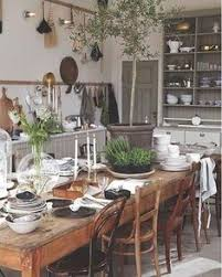i adore this rustic farmhouse dining room kitchen the plants and greenery make it