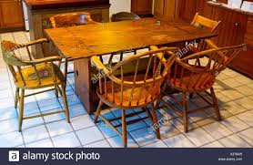 A Very Old Antique Dining Set With A Table And Chairs In A Kitchen