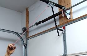 some door openers have a neutral position for the trolley disconnect on older openers you may need to remove the l shaped drawbar arm