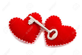 stock photo two hearts and a key to signify opening of one s heart to love