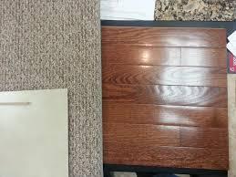 hardwood carpet and secondary bath floor tile