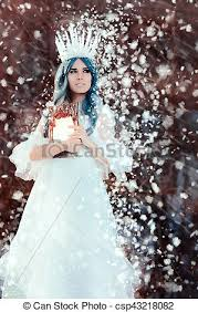 Snow queen holding mirror in winter fantasy Beautiful pictures