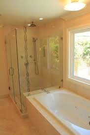 master bathroom remodel complete with jacuzzi tub, large walk in stone shower  bathroom