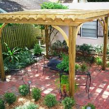 Simple Pergola wooden pergola with pink paved patio using elegant wrought iron 6496 by xevi.us