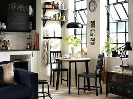 dining table in living room black and white kitchen with small round table and two chairs