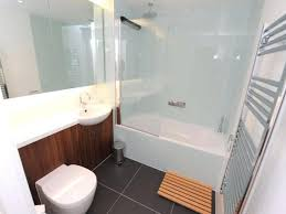 medium size of unused bathtub storage ideas bathroom baby impressive with glass door and divider wooden