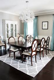 toronto pottery barn edison chandelier dining room traditional with blue curtain metal candleholders dark wood floor