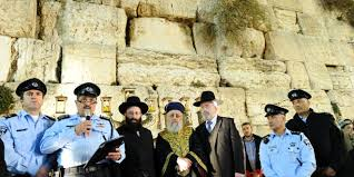rabbi of the western wall shmuel rabinovich chief rabbi of israel itzhak yosef take part in lighting the hanukkah candles on the large menorah set breaking lighting set