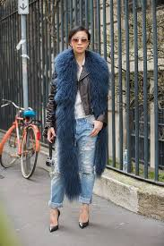 street style jeans and leather jacket with faux fur scarf