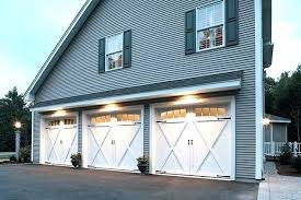 barn style garage doors barn garage doors garage with vinyl siding and three white barn carriage