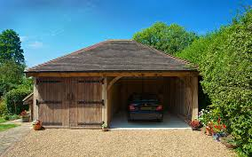 this two bay cart barn garage features two diffe sized bays the bay on