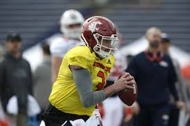 north squad quarterback luke falk of washington state in action during the north teams practice for