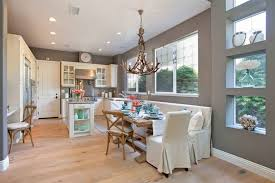 cottage style breakfast nook boasts antler chandelier