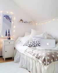small and narrow teenage girl attic bedroom design with simple decoration painted with white interior color plus corner bed and string lights ideas