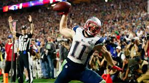 new england wide receiver julian edelman spikes the ball after his fourth quarter touchdown catch