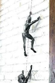 wall climber sculpture wall climber sculpture wall sculpture climber climbing man wall climber wall decor mountain