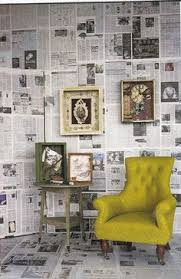 love the newsprint wallpaper background, the mixture of frames and colors,  and love that chair-style and color. old newspaper clippings on kitchen wall
