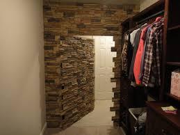 hidden wall door. hidden door made for a walk-in closet using norwich stacked stone panels. wall