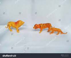 Tiger Vs Lion Toys Fighting White Stock Photo (Edit Now) 1246648999