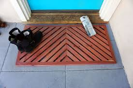 a diy wooden doormat is a stunning statement right at your door this step